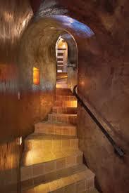 basement curved stair rail adg lighting basement stairway lighting