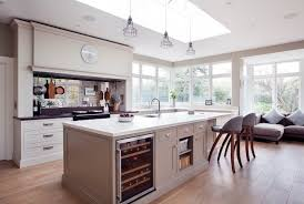 antiqued mirror backsplash kitchen farmhouse with window sill luxury kitchen counter stools cabinet lighting backsplash home
