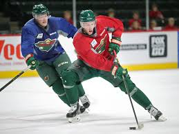 six keys to the wild taking the next step this nhl season elizabeth flores x2022 eflores com wild winger charlie coyle maneuvering past tyler graovac during training camp will try to build on a