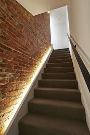 using led strip lighting makes the brick wall the focal point while making it easy to absolutely nicking lighting idea