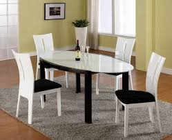 black and white dining table set: modern dining sets in white and black theme with oval transparent glass dining table also