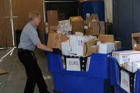 photos richard hayes 376th expeditionary communications squadron postal technician realigns mail bins after sorting mail