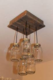 mason jar chandelier reclaimed wood pallet by partyandhomedesign 15000 alternating length wagon wheel mason jar