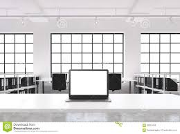 a workplace in a bright modern loft open space office a working desk is equipped bright modern office space