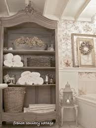 even a grand bathroom might lack adequate storage space for toiletries with doors removed this antique armoire holds and displays pretty soaps potions adequate storage space