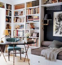 the built in light above the reading nook and the arrangement of books and collectables on the shelves designer matthew patrick smyth added a graceful note bookcase book shelf library bookshelf read office