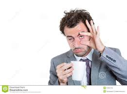 stay awake concept or workaholic royalty stock images image a businessman holding a cup of beverage and trying hard to stay awake royalty stock