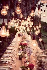 edison lighting hanging over wedding reception table backyard wedding lighting