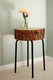 awesome table made from upcycled bar stool metal legs and a slice of tree trunk for awesome tree trunk table 1