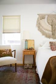 kitty otoole elegant whimsical bedroom: macrame over the bed gregory and jennys relaxed hippie bungalow house tour apartment therapy