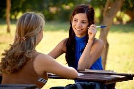 bring an end to hassles of writing academic papers educationdocs young women at school two female friends talking and studying for college test in park specialized academic paper writers
