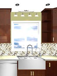 lighting above kitchen sink we39d probably move some of those recessed lights over at this point above sink lighting