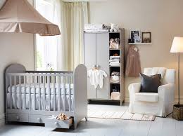a nursery with a light grey cot with drawers and a wardrobe combined with a bedroom furniture ikea uk