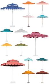 white striped patio umbrella: poolside glamour a la slim aarons stylish patio umbrellas palm springs style