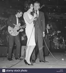 british pop singer mike sarne performing on stage at the pop prom british pop singer mike sarne performing on stage at the pop prom at the royal albert hall partner billie davis 16th 1962