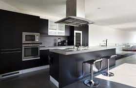 black appliance matte seamless kitchen: european design kitchen with black theme and gray counters