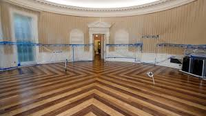 oval office floor. the hardwood floor of oval office is resurfaced as west wing white house in washington undergoes renovations while president donald trump e