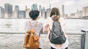 american english for english language teachers around the world two young women their backs to the camera stand facing a river a big