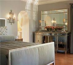 bedroom by lori carroll what better to pair with mirrored furniture than a monochromatic silvery bedrooms mirrored furniture