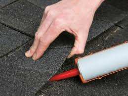 roof repair place: coat nails with adhesive and press in place
