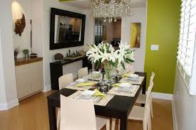 dining room wall decorating ideas: dining room dining room wall decor ideas dining room decorating ideas black table ivory chairs olive wall wooden floor large mirror crystal chandelier a