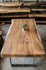 wood slab dining table beautiful: compared to table tops which are created from jointed wood planks a solid live edge wood slab is elegant and beautiful
