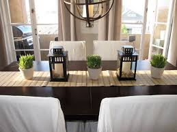 room simple dining sets: frean natural green table plant in white vase and black candle jar on brwon dining