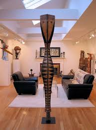 african theme living area with warm wood flooring and natural lighting furniture contemporary african inspired furniture