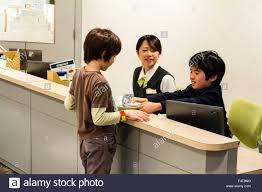 nishinomiya kidzania bank interior child drawing bank interior child drawing money from boy cashier adult w supervisior