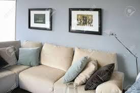 cream couch living room ideas: beautiful living room with cream sofa living room with cream sofa soft blue wall interior design