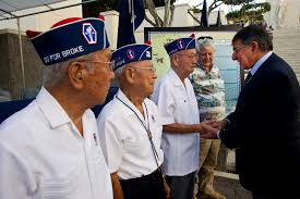 u s department of defense photo essay defense secretary leon e panetta shakes hands world war ii veterans after placing a