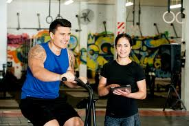 skills employers are looking for basic skills employers look for hero image of a female maori personal trainer smiling at the camera as a young male