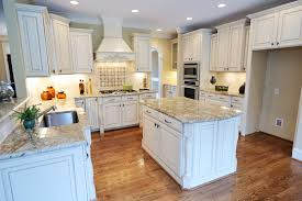 granite white cabinet kitchen island this kitchen is particularly inviting with intricate white cabinetry a