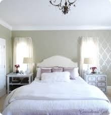 colors light grey walls cream headboard white and purple bedding splash of black or white furniture