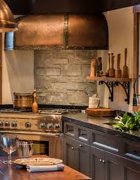 st charles kitchen cabinets: handmade copper and steel hammered hood over thermador quot range nightfall color painted cabinets st charles il
