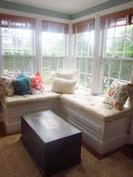 storage bench for living room: window with accent pillows a wooden chest with a ship painted