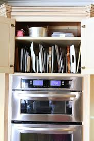 photos kitchen cabinet organization: organized pots amp pans storage this is a really easy great way to store