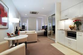 stunning design of the brown rugs ideas added with white wall and white cabinets as the compact apartment furniture