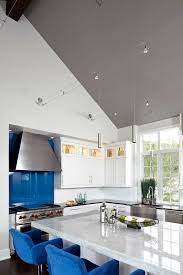 wire track lighting in kitchen contemporary with glass front uppers blue counter seats blue track lighting