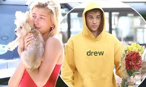 Hailey Baldwin cuddles <b>cute puppy</b> as Justin Bieber buys bouquet of ...