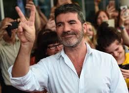 Simon Cowell Broke Back Falling From <b>Motorbike</b>, Not <b>Electric Bike</b>