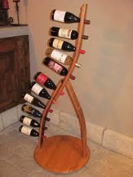 david 5 bottle table top arched wine stave rack mounted on barrel head stave james 11 bottle wine stave rack mounted on barrel head matthew 16 arched table top wine cellar furniture
