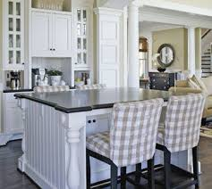 island design ideas designlens extended: seating on both sides is it a dining table or a kitchen island its both thanks to a wide surface that extends beyond the base storage on two sides of