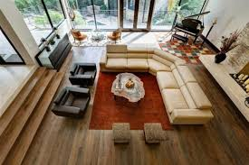 rugs living room nice: nice living room with wooden floor orange rug beige sofa and black sofa from above image