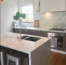 calacatta marble kitchen waterfall: calacatta bench splashback balaclava job
