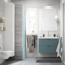 washstand bathroom pine: a light grey small bathroom with a white high cabinet a mirror and a grey