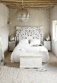 all white moroccan bedroom inspiration with a carved treasure chest and headboard woven jute bedroomterrific eames inspired tan brown leather short