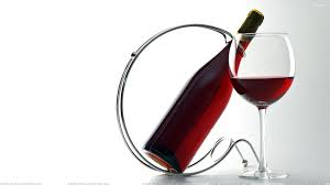 red wine glass n bottle in stand bottle red wine