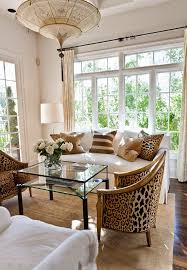design ideas betty marketing paris themed living: living room sitting room chandelier leopard chairs pillows white sofa couch better decorating bible blog