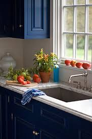 painted blue kitchen cabinets house: blue kitchen inspiration photo quentin bacon for house beautiful house amp home quotwhite carrara marble countertops finished with a traditional ogee edge